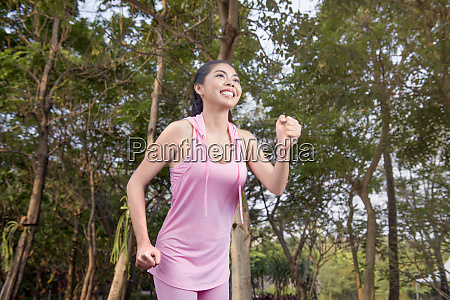 beautiful asian woman with sportswear running