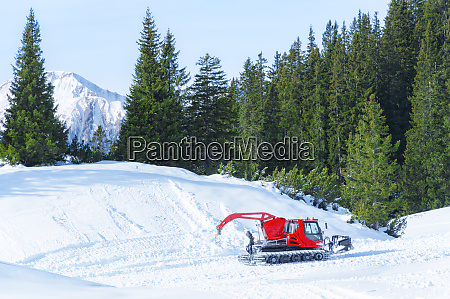 tracked snow groomer in the alps