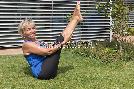 smiling senior blond woman is exercising