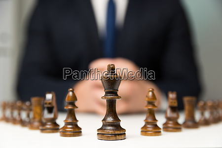 businessman with clasped hands planning strategy