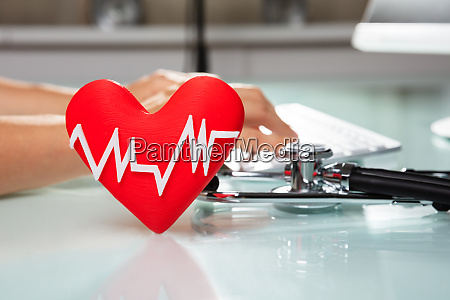 red heart with heartbeat pulse