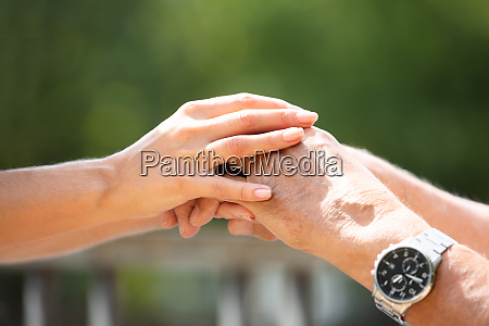 woman holding her fathers hand