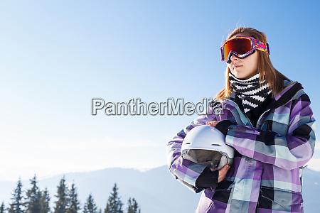 blonde in helmet among mountains