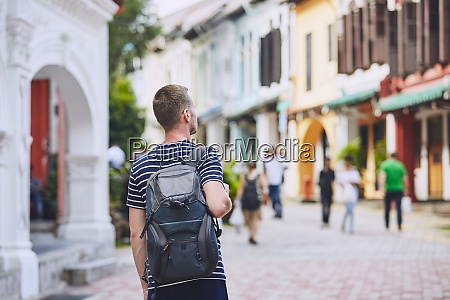 young traveler in city