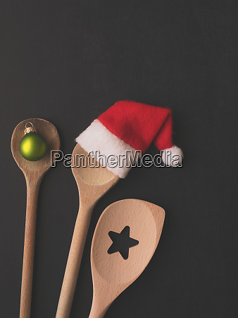 wooden cooking spoon with hat of