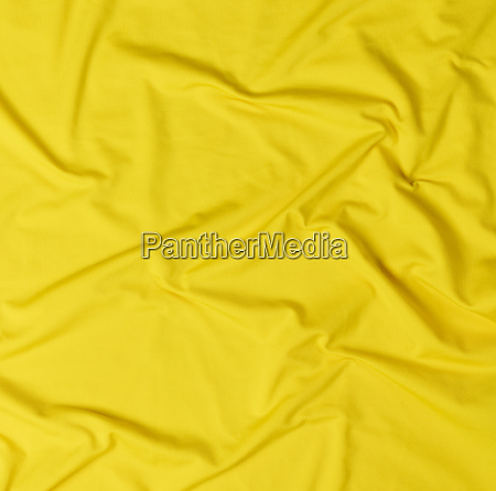 fragment of yellow crumpled cotton fabric