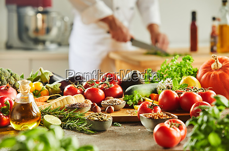 cutting board with food and man