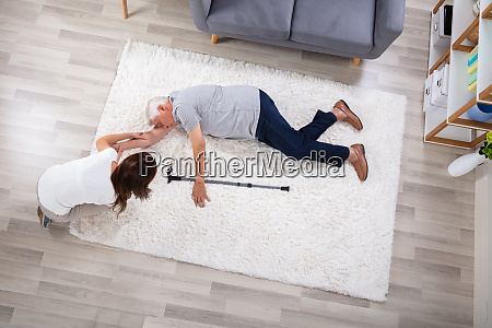 woman looking at her unconscious father