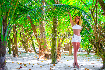beautiful laughing woman stands on tiptoe