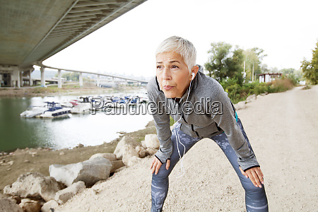 active senior running woman resting after