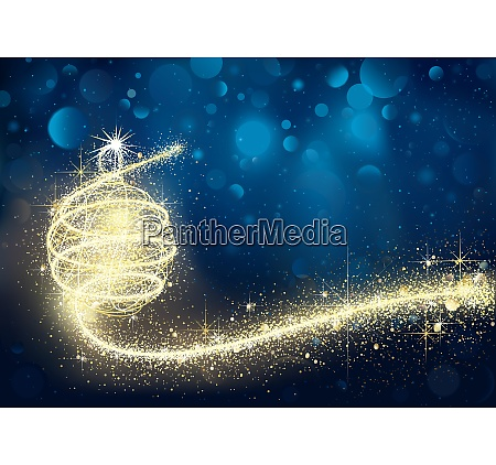 golden christmas bauble in blue bokeh