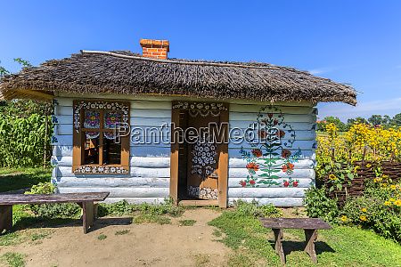 painted old wooden cottage decorated with