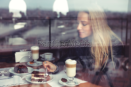 nice female in cafe eating cake