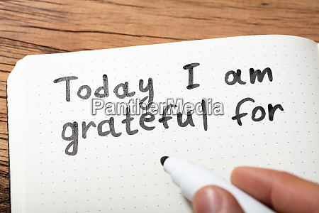 person writing today i am grateful