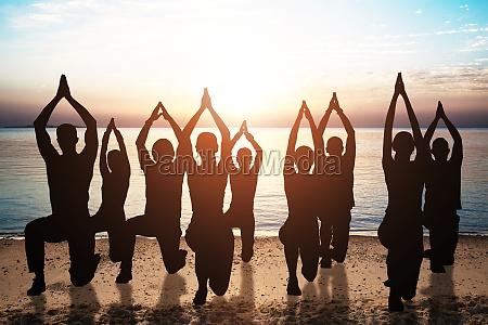 group of people doing aerobics exercises