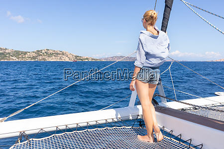 woman relaxing on a summer sailin