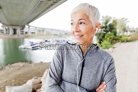 smiling senior woman relax listening music