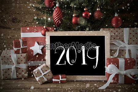nostalgic christmas tree with 2019 snowflakes