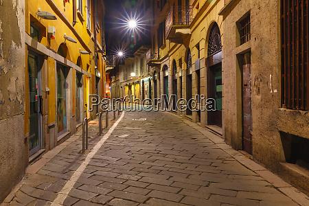 medieval street at night in milan