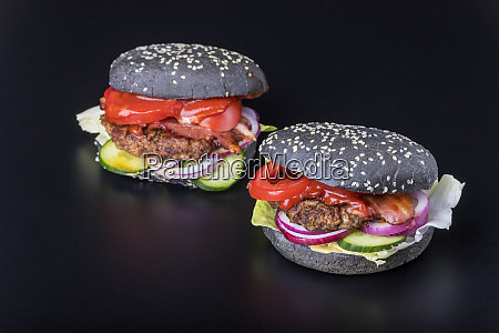 closeup of black hamburgers on black