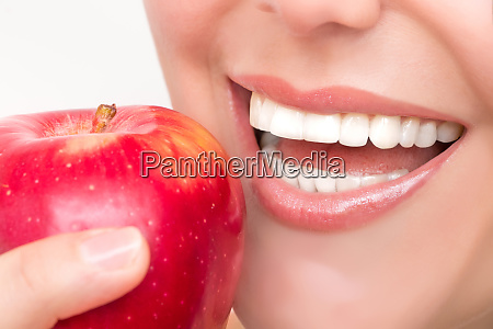 beautiful female mouth with white teeth