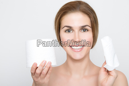 woman holds a piece of toilet