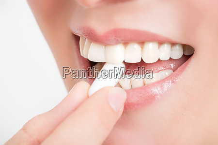 film tablet between the teeth of