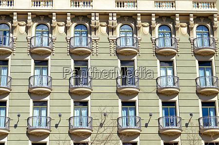 facade with beautiful balconies in barcelona