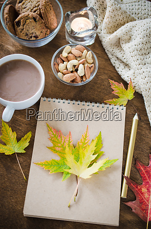 blank brown notebook with knitted blanket