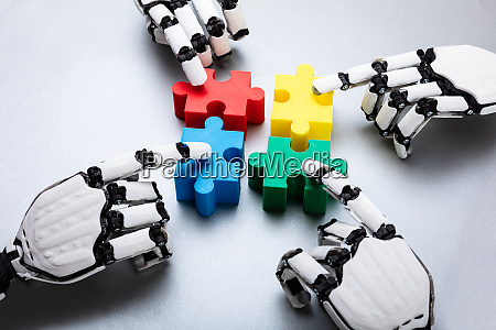 robot touching jigsaw puzzle pieces