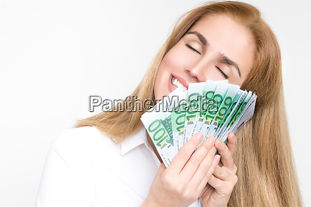 gorgeous blonde woman holds 100 euro