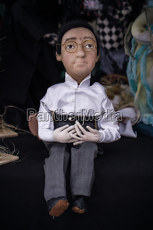 various handmade dolls in a gift