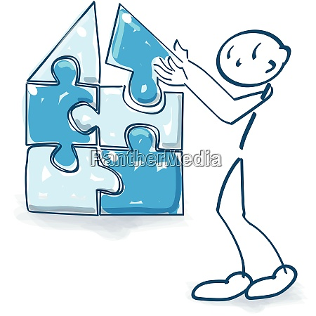 stick figure builds a house with
