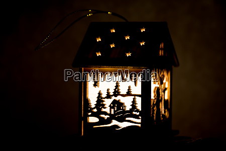 illuminated lantern with winter motive