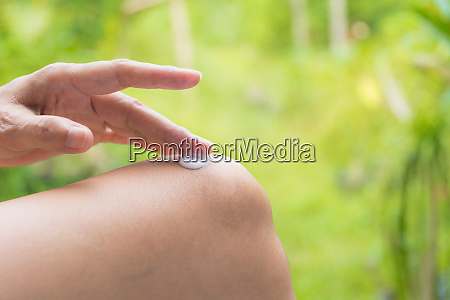 hand of woman apply lotion on