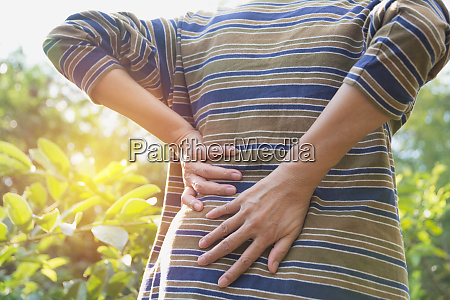 a man suffering from backache spinal