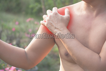 man suffering from shoulder pain acute