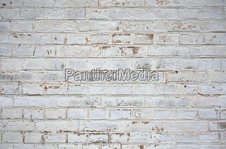 old weathered white brick wall
