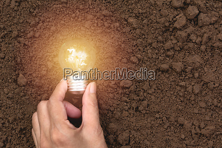 hand with light bulbs with glowing