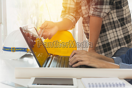 architect engineer using laptop for working