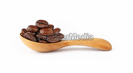 wooden spoon of roasted coffee beans