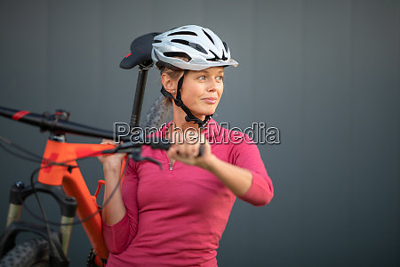 pretty young woman biking on a