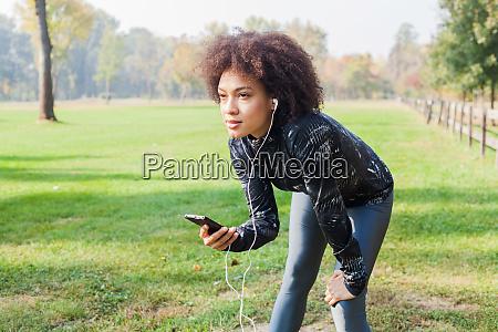sporty afro woman take a break