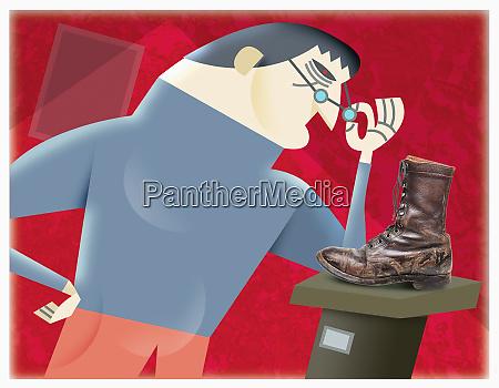 man looking at artwork shoe