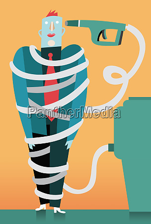 businessman wrapped in fuel pump hose