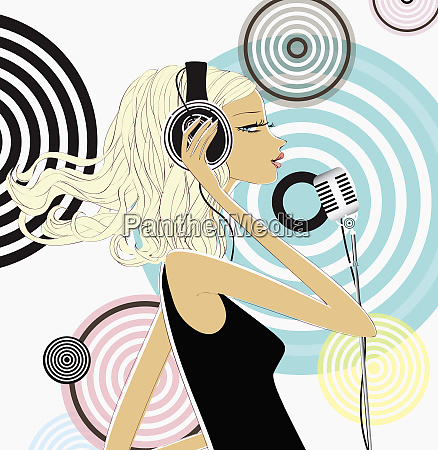 woman wearing headphones and singing into