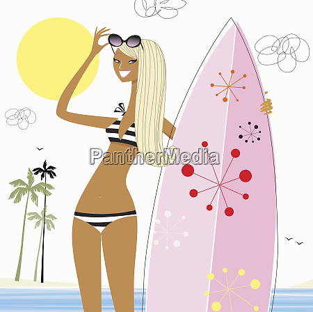 woman holding surfboard on beach