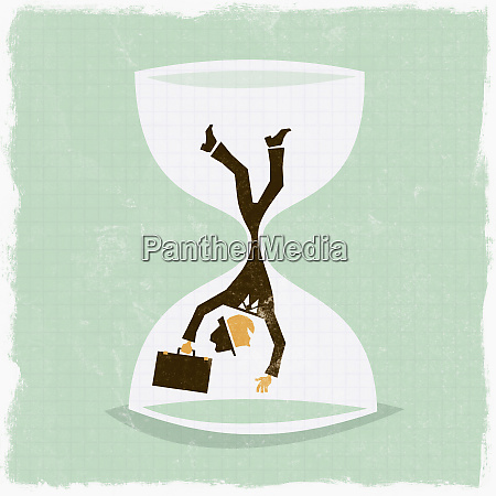 businessman falling in hourglass