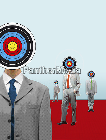 businessmen with targets for heads