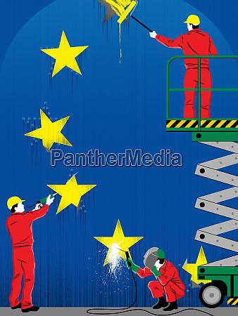 workers repairing stars of european flag
